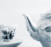 Ceramic teapot and cup Stock Images
