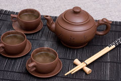 Ceramic teapot and cups Stock Photos