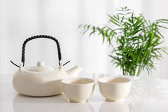 Ceramic teapot and cups on the table Stock Photography