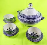 Ceramic teapot isolated on green background morocco stock photo