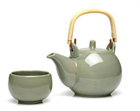 Ceramic teapot and a tea cup Royalty Free Stock Photography