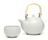 Ceramic teapot and a tea cup Royalty Free Stock Photos
