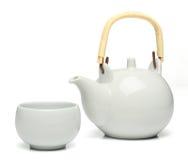 Ceramic teapot and a tea cup Royalty Free Stock Photos
