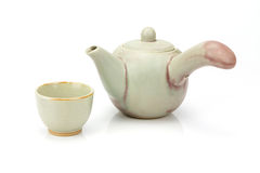 Ceramic teapot and tea cup isolated Royalty Free Stock Photography