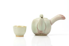 Ceramic teapot and tea cup isolated Stock Photo