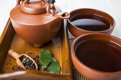 Ceramic teapot and tea leaves Stock Photos
