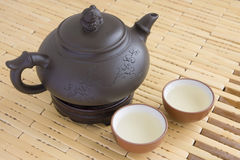 Ceramic teapot with two cups Stock Images