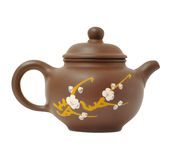 Ceramic teapot on white. Brown,ware teapot with sakura pattern isolated Royalty Free Stock Photo