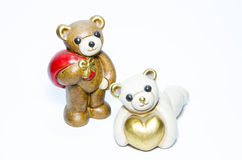 Ceramic teddy bears with gifts and a heart Stock Photography