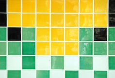 Ceramic Tile. Old ceramic tile in green, yellow, white and black Stock Images
