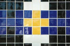 Ceramic Tile. Old ceramic tile in blue, yellow, black, and white Stock Images