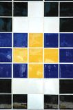 Ceramic Tile. Old ceramic tile in blue, black, white and yellow Royalty Free Stock Images