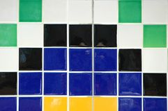 Ceramic Tile. Old ceramic tile in black, blue, white, yellow and green Stock Images
