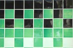 Ceramic Tile. Old ceramic tile in green, black and white stock photos