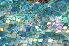 Ceramic tile on the bottom of a clear pool Royalty Free Stock Photography