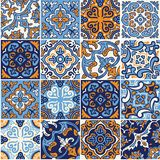 Ceramic tile with colorful patchwork in spanish style. Spanish ceramic seamless pattern in blue and orange colors. Mosaic patchwork ornaments for design and royalty free illustration