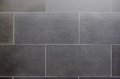 Ceramic tile, dark square seamless texture-gray, tile flooring Stock Images