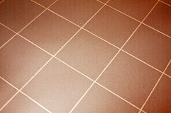 Ceramic tile floor. Brown color. Shallow DOF Stock Photo