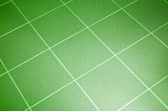 Ceramic tile floor. Green color. Shallow DOF Royalty Free Stock Photos
