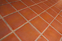 Ceramic tile flooring orange. Royalty Free Stock Photos