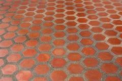 Ceramic tile flooring orange. Stock Photography