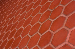 Ceramic tile flooring orange,shooting angle in obliquely. Royalty Free Stock Photography