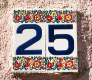 Ceramic tile with house number 25 Royalty Free Stock Photos