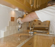 Ceramic tile installation on kitchen backsplash 12 Royalty Free Stock Photos