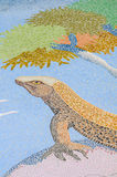 Ceramic tile patterns and colors. Lizard on a rock, in the shade of a tree Stock Photos
