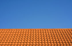 Ceramic tile roof against a blue sky Stock Image