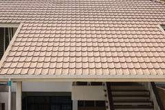 Ceramic tile roof on background of house. Ceramic tile roof on a background of house Stock Image