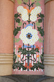 Ceramic tiled detail on pillar of building in Barcelona, Spain. Colourful ceramic mosaic detail on pillar with floral design in Barcelona, Spain stock photography
