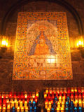 Ceramic tiled panel and candles offering. Inside Montserrat Basilica, Catalonia, Spain Stock Photos