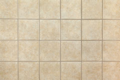 Ceramic tiles. Beige ceramic tiles on the wall. Design background Royalty Free Stock Photos