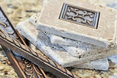 Ceramic tiles and borders. For backsplash close up on a granite surface stock image
