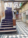 PASSAGE WITH DAMAGED STAIRS, DOOR, WINDOW AND FACADE, HAVANA, CUBA Stock Photography