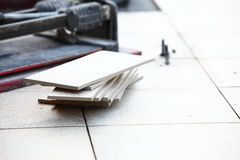 Ceramic tiles for floor and trowel for repairs Stock Image