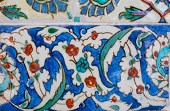 Ceramic tiles with flowers on designed wall of famous historical Topkapi palace, Istanbul. Stock Photo