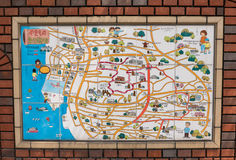 Ceramic tiles illustrating map of Tokoname pottery village area. Ceramic tiles on brick wall, illustrating map of Tokoname pottery village and the vicinity Royalty Free Stock Images
