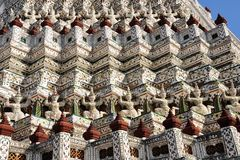 Ceramic tiles and statues detail of Wat Arun, Bangkok royalty free stock photo