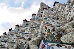 Ceramic tiles and statues detail of Wat Arun, Bangkok royalty free stock photography