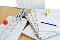 Ceramic tiles with tile cutter Royalty Free Stock Image