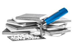Ceramic tiles and tools closeup. On white background Stock Photo