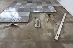 Ceramic tiles and tools for tiler. Floor tiles installation royalty free stock image
