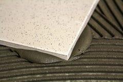 Floor tiles installation stock photo image of create for Hom flooring