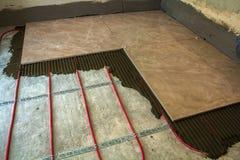 Ceramic tiles and tools for tiler. Floor tiles installation. Hom. E improvement, renovation - ceramic tile floor adhesive Stock Image