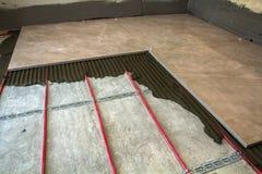 Ceramic tiles and tools for tiler. Floor tiles installation. Hom. E improvement, renovation - ceramic tile floor adhesive Stock Photography