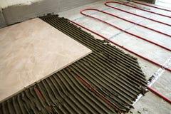 Ceramic tiles and tools for tiler. Floor tiles installation. Hom. E improvement, renovation - ceramic tile floor adhesive Royalty Free Stock Photo