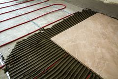 Ceramic tiles and tools for tiler. Floor tiles installation. Hom Royalty Free Stock Photos