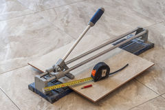 Ceramic tiles and tools for tiler. Floor tiles installation. Hom Stock Image